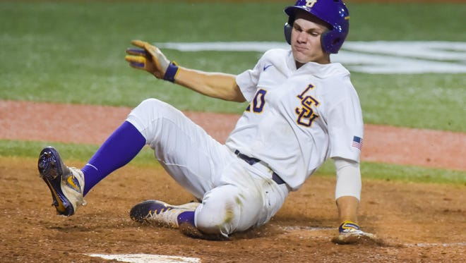 Antoine Duplantis slides to score a run as Mississippi State takes on LSU in the NCAA Super Regional at Alex Box Stadium in Baton Rouge, LA.- Saturday, June 10, 2017.