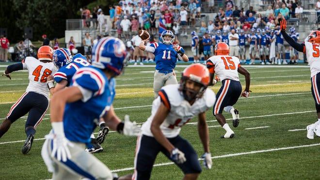 August 18, 2017 - Memphis University School's Bobby Wade goes to make a pass during Friday night's game versus Ridgeway High School.