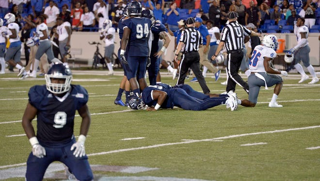 September 9, 2017 - Jackson State University players fall to the ground after their kicker missed what would have been a game-winning field goal as time expired in the fourth quarter of the Southern Heritage Classic football game between Tennessee State University and JSU at Liberty Bowl Memorial Stadium in Memphis, Tenn. TSU won 17-15. (Brandon Dill/Special to The Commercial Appeal)