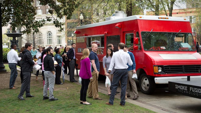 At the CA Lunch Bunch Food Truck Rodeo, we'll have several food trucks. You pick what you want to eat like these customers did at a food truck rodeo at Court Square.