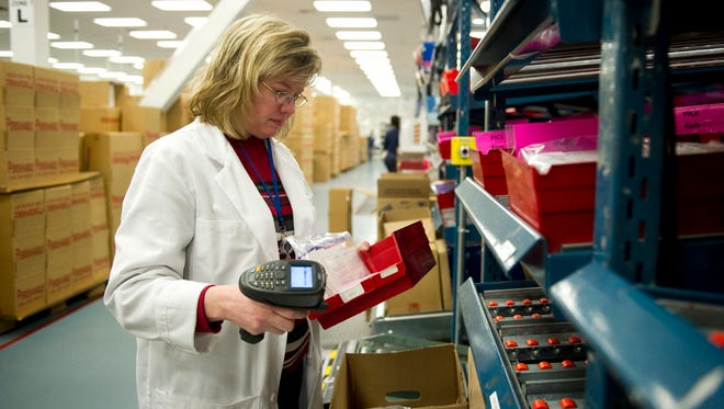 Dec 13, 2012 - Pharmacist Christen Stotts checks information on a tray of prescription drugs before they are shipped from the Accredo pharmacy. The drug-distribution company annually handles 1.4 million shipments of pharmeceuticals for chronically ill patients. (Brandon Dill/Special to The Commercial Appeal)