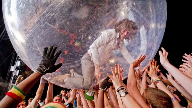 Wayne Coyne of The Flaming Lips is living the dream by crowd-surfing inside a giant hamster ball. Help keep him aloft at Bellwether Festival this weekend.
