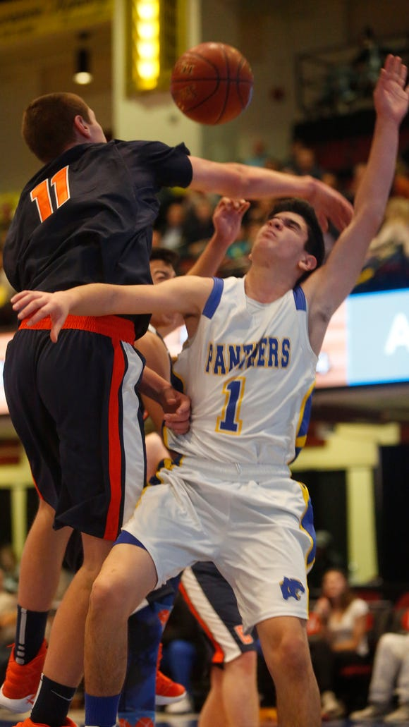 Briarcliff's Spencer McCann, left, and Ardsley's Frankie Belarge battle for a rebound during the challenge game at the 18th Annual Slam Dunk Tournament at the Westchester County Center in White Plains on Wednesday.