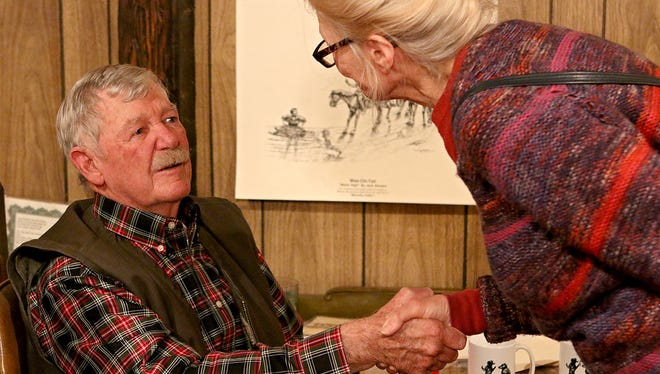 Jack Stevens is greeted by a guest of his open hosue and retirement party Saturday at his home in Iowa Park.