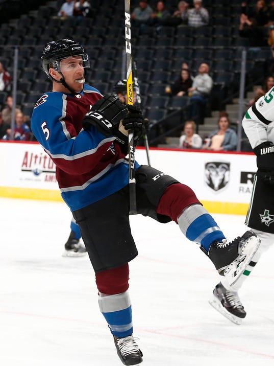 Colorado Avalanche defenseman David Warsofsky celebrates a goal against the Dallas Stars during the first period of a preseason NHL hockey game Thursday, Sept. 21, 2017, in Denver. (AP Photo/Jack Dempsey)