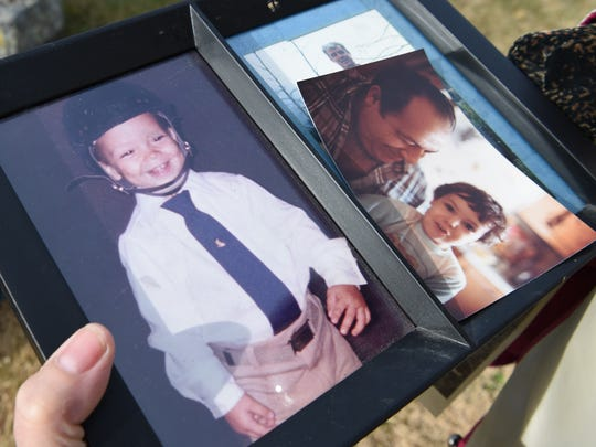 Christine Weiner holds photos of her son John Weiner, who is buried at St. Peter's Cemetery in the Town of Poughkeepsie.