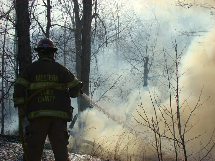 The Western Taney County Fire District was dispatched to a report of a Natural Cover Fire at 289 Ruby's Rest Road north of Branson. When Crews Arrived on scene, They found a large shop building on fire and a residential structure immediately threatened by the fire.