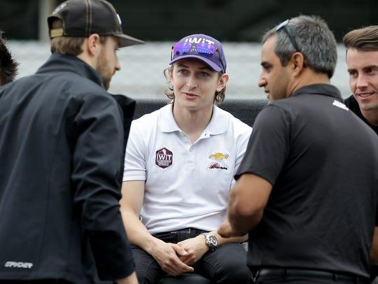 Zach Veach (center) talks with Juan Pablo Montoya,