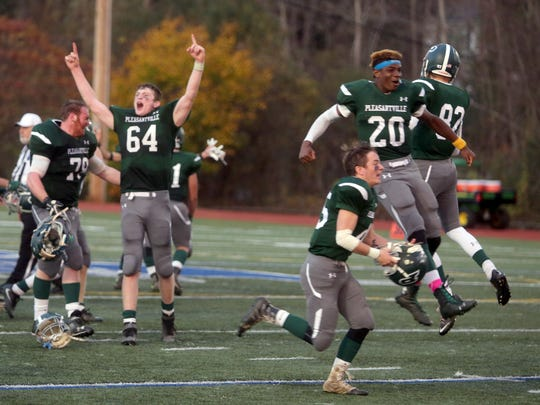Pleasantville celebrates after defeating Westlake 28-21 to win the Section 1 Class B football championship against Scarsdale at Mahopac High School Nov. 6, 2016.