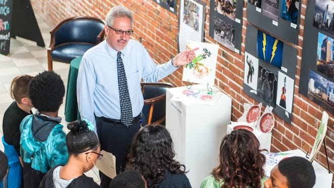 Bob Trivellini speaks to Silver Run fifth graders at the Riverfront Renaissance Center for the Arts in Millville as part of Millville School District's Multicultural Week activities on Wednesday, May 31.