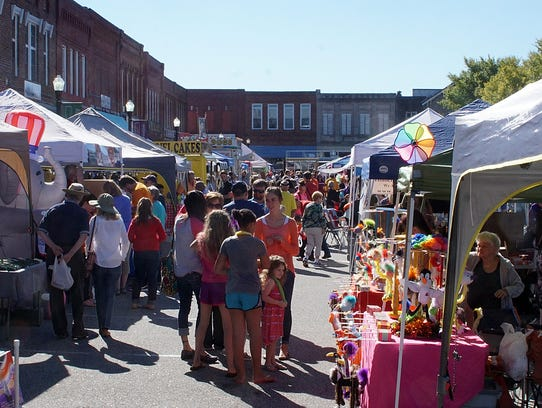 People fill the town square in Belton on Saturday as