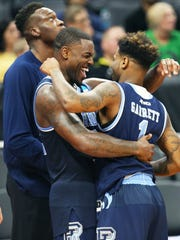 Rhode Island guard Jared Terrell (32) and teammate Jarvis Garrett (1) celebrate their win over Creighton during a first-round game in the NCAA college basketball tournament in Sacramento, Calif., Friday, March 17, 2017. Rhode Island won 84-72.