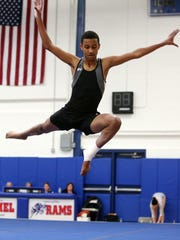 Ossining's Cruz Vernon competes in the Floor Exercise