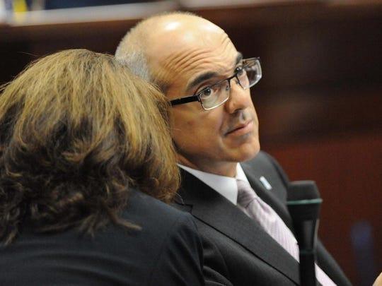 Nevada state Sen. Mo Denis listens to Sen. Debbie Smith