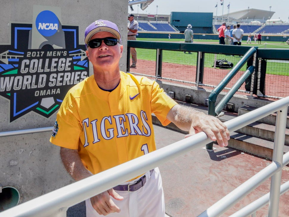 LSU coach Paul Mainieri talks to an acquaintance in the stands following team practice in Omaha, Neb., Friday, June 16, 2017. LSU plays Florida State in the NCAA baseball College World Series on Saturday.