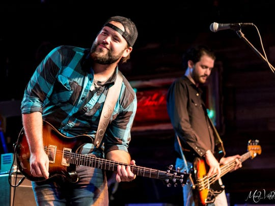 Singer-songwriter Mike Ryan performs at Brewster Street Ice House on Thursday.