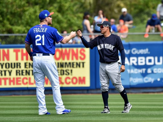 Todd Frazier interacts with former teammate, Ronald Torreyes.