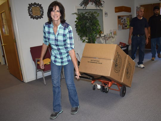 Deneen Black brings in donations from Grace United Methodist Church.