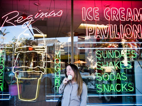 4 p.m. Ashley Collins enjoys a cone of birthday cake ice cream outside of Regina's on 5th Avenue on Thursday, January 4, 2017 in Naples.