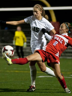 Wall's Amy Paternoster gets her foot on ball as she battles with Colts Neck's Nicole Loehle for control. Colts Neck vs Wall Girls SCT Soccer Final in Neptune NJ on November 1, 2014. Peter Ackerman /Staff Photographer