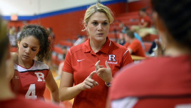 Amanda Cauley head coach of the Ruston girl's volleyball talks with her team between games.