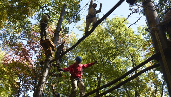 Veterans on Crew 6 negotiate a tricky ropes course at the North Carolina Outward Bound School.