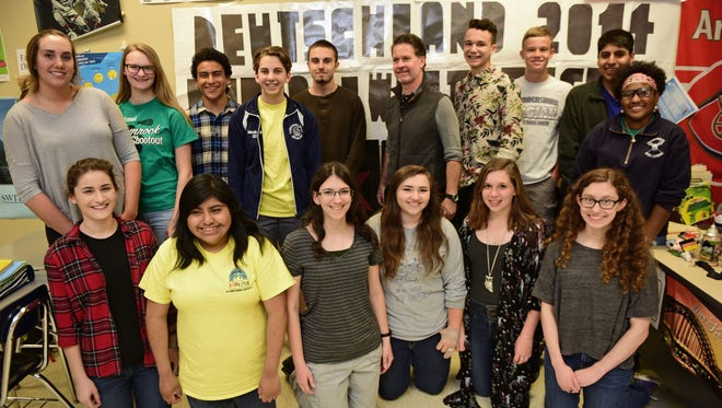 Teacher Paul Unruh, center, photographed Thursday,  April 28, 2016, is headed to Germany with his students this summer. The CASHS students willl be visiting some of the exchange students who visited their school and area.