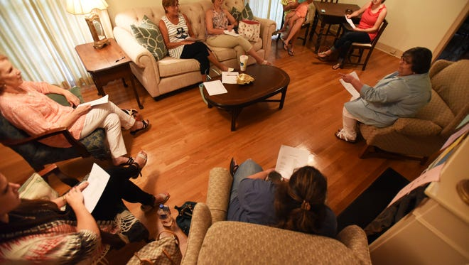 Embrace Grace volunteers meet at Mary's House, they are an organization that helps young women facing unplanned pregnancies.