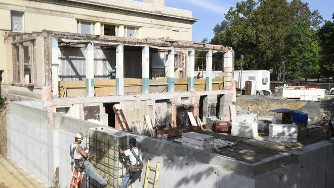 In this file photo from Sept. 24, the first walls of the addition to Coyle Free Library were going up along East King Street. Library officials have announced the campaign has raised $1 million of the $2.5 million needed for the $5 million project.