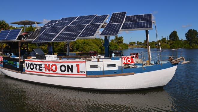 """Captain Carter Quillen made a stop at Front Street Park on the Florida east coast Solar Truth Voyage, promoting """"Vote No"""" on Amendment 1. His boat is a 50 foot diesel-solar hybrid."""