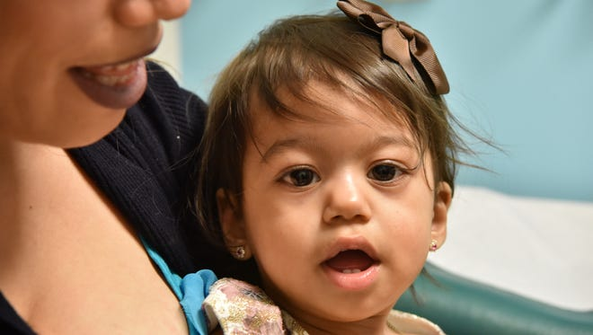 Sofia, 14 months, previously diagnosed with rare Pompe disease, with her mother Nicaury Paulino, at St. Joseph's Regional Medical Center in Paterson, NJ.