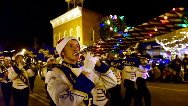 A member of the Clyde High School band plays in a past Winesburg Christmas parade. The band will be returning to perform in this Saturday's parade.