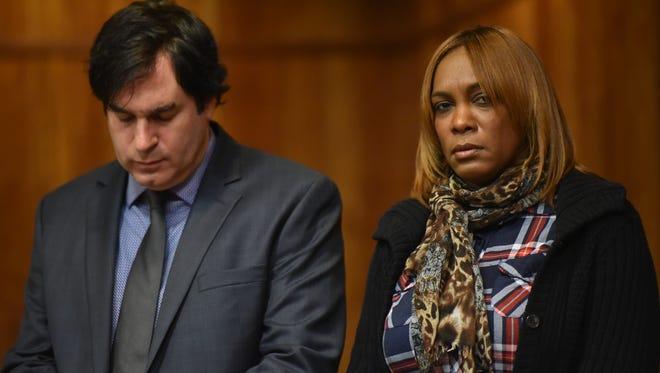 Brunilda Garcia in court Friday with her attorney Ron Bar-Nadav. Garcia, a former Paterson PD records clerk, pleaded guilty of selling heroin out of her home.