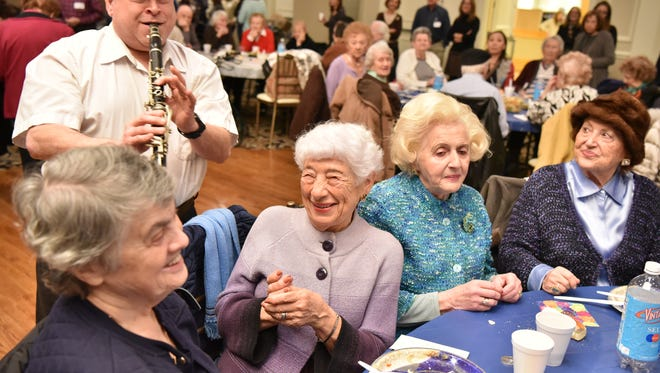From left, Holocaust survivors Faniya Rudner, Lilia Becker and Asya Shindelman were among those enjoying music Tuesday at a social gathering organized by Jewish Family Services in Fair Lawn.