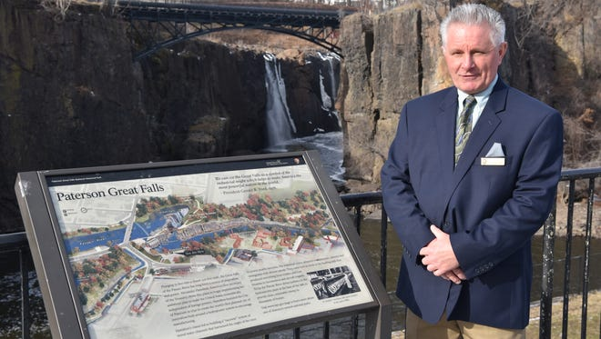 Dr. Paul Kovalski of Monmouth County completes his tour of the more than 400 sites in the National Park System at Paterson's Great Falls on Friday, December 23.