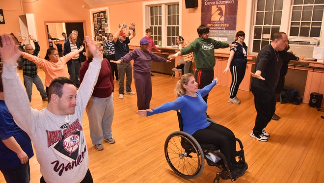 Mike Michaels, left, dances at a class for adults with special needs at the Center for Modern Dance Education in Hackensack on January 11, led by instructor Fred Kaps, right, and his assistant Amanda Trott, in blue.