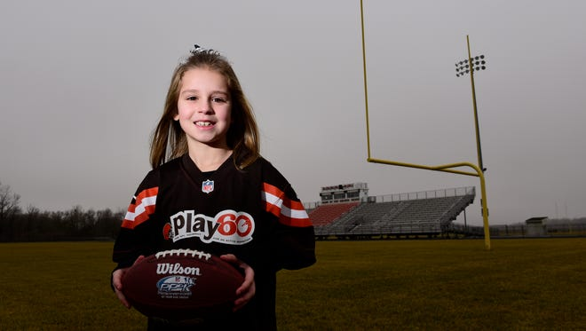 Elly Evarts, 7, of Gibsonburg is competing in a national punt, pass and kick competition in Orlando.