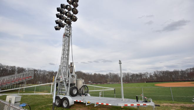 The council reintroduced an ordinance to allow lighting at school athletic fields, making one adjustment to height restrictions.