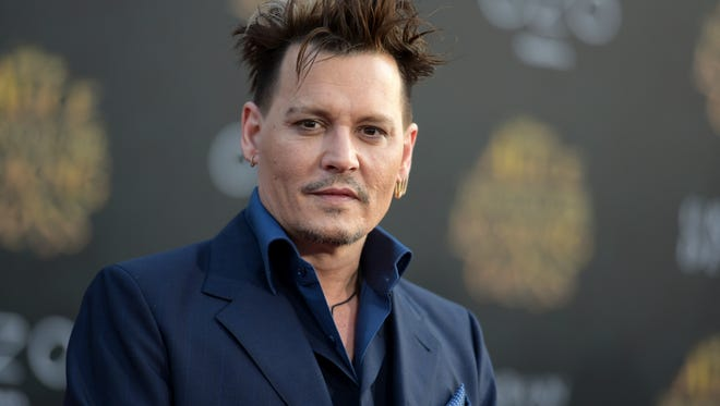 "In this May 23, 2016 file photo, Johnny Depp arrives at the premiere of ""Alice Through the Looking Glass"" at the El Capitan Theatre, in Los Angeles. Depp's former business managers countersued the actor on Tuesday, Jan. 31, 2017, stating that they frequently advised him that his spending was out of control. Depp sued his former business managers earlier this month alleging they mismanaged his money."