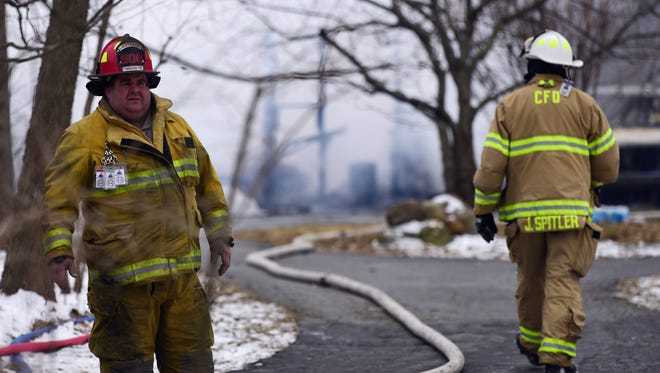 A man was found dead at the scene of a fire that destroyed a house and three vehicles Friday afternoon on County Road 233 in Riley Township.