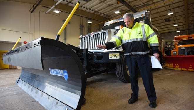 Bergen County Executive Jim Tedesco inspects a salt & plow truck prior to  a press conference to announce a county-wide State of Emergency in anticipation of Winter Storm Stella, photographed at Bergen County Annex Building in Paramus on March 13th, 2017.