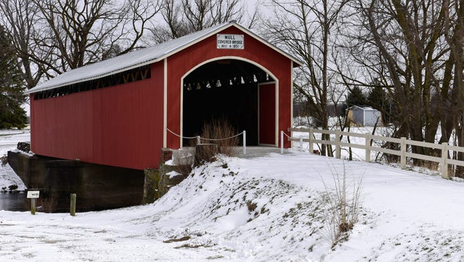 The Mull Covered Bridge in Ballville Township, restored last year, was dusted with snow during the late spring storm that hit the county Monday and Tuesday.
