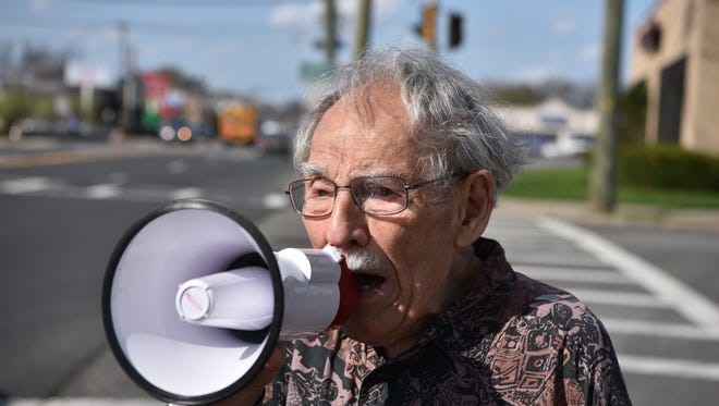 99 year old peace activist Henry Shoiket participates in an anti-war rally in Teaneck on Wednesday.