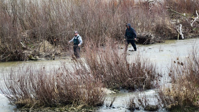 Fishermen looked for a catch in the Sandusky River in early April. The Fremont Fishing & Outdoor Festival will be held April 29 in downtown Fremont.