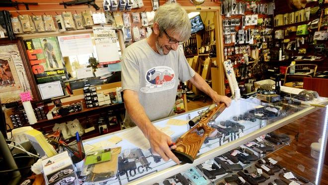 Gene Mock, co-owner of Ron's Guns, helps a customer in Bossier City.