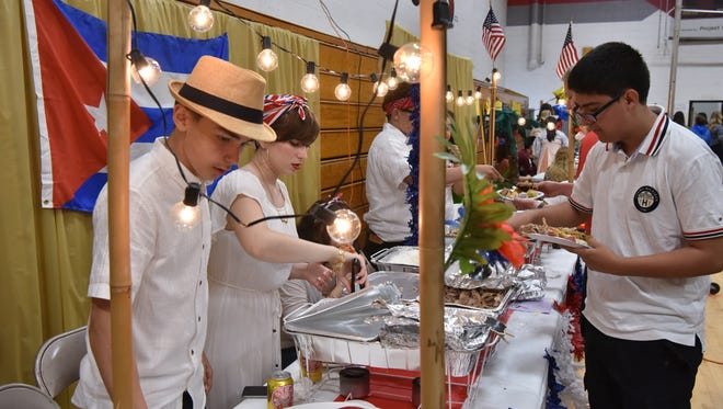 Julien and Mackenzie Fernandez ran the Cuban food stand during a 'We Are All Americans,' day, a celebration of student diversity and multiculturalism at Leonia High School on Friday.