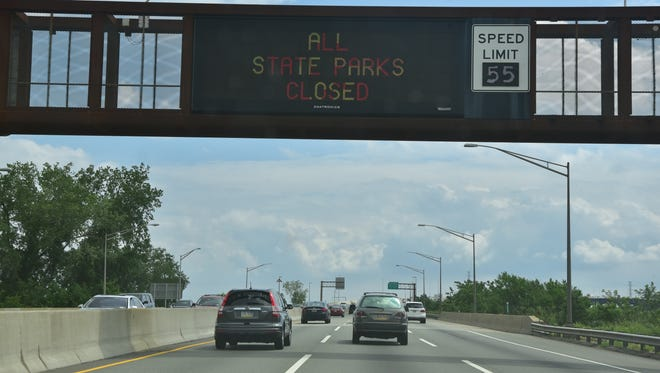 A sign on the freeway alerts motorist of NJ state parks closures due to New Jersey government shut down. Marko Georgiev/NorthJersey.com