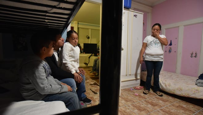 Jose Estrada Lopez, with his son Christopher, daughter Katherine and wife Gloria Chocoj wait for their ride to Newark International Airport early Saturday morning. Jose, a father of three U.S. born children, who has been living in the United States for nearly two decades was deported to Guatemala on Saturday.