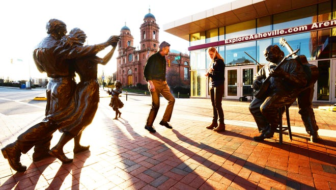 Warren Wilson College professor Phil Jamison demonstrates some dancing outside the U. S. Cellular Center in Asheville last year.