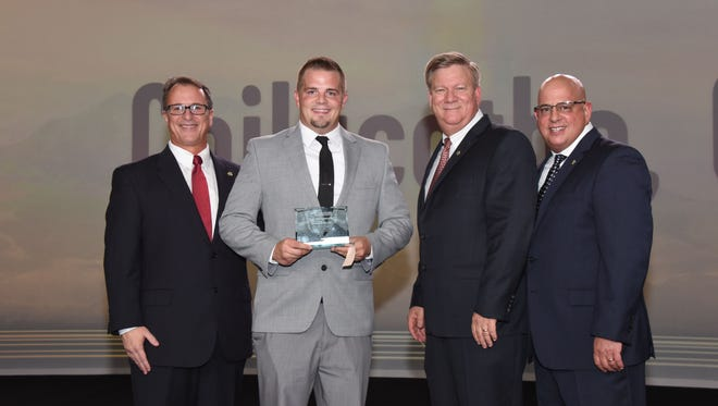 """Michael Mcclaskey, Jr., Managing Partner of the LongHorn Steakhouse in Chillicothe, Ohio, has recently accepted the company's """"Team Excellence"""" Award on behalf of his restaurant team."""